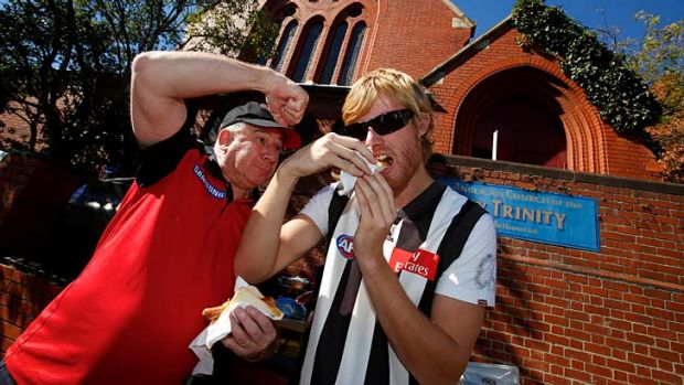 Graham Jenkin and Lachie Mika partake in a sausage sizzle outside the Holy Trinity Anglican Church in East Melbourne on ...