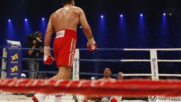 Over and out: Alex Leapai is knocked out by Wladimir Klitschko.