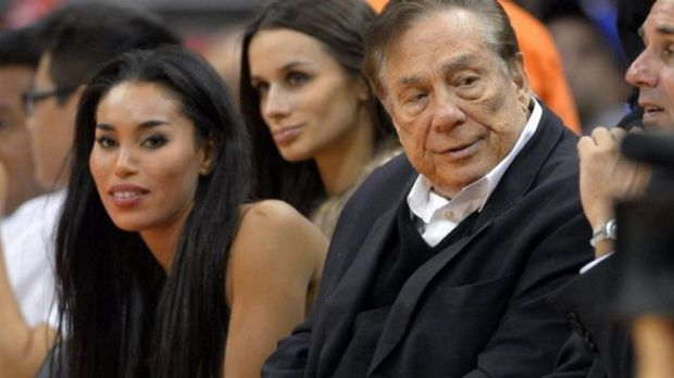 Los Angeles Clippers owner Donald Sterling, right, and V. Stiviano, left, watch the Clippers play the Sacramento Kings ...