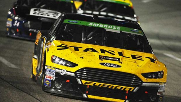 Marcos Ambrose leads a pack of cars during the NASCAR Sprint Cup Series at Richmond International Raceway.