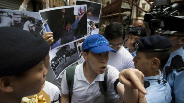 A pro-China demonstrator in support of the Chinese government's crackdown on the 1989 Tiananmen Square pro-democracy ...