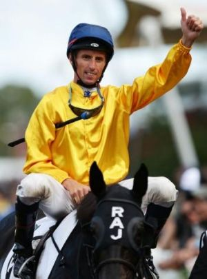 Nash Rawiller salutes after victory in the BMW on Silent Achiever.