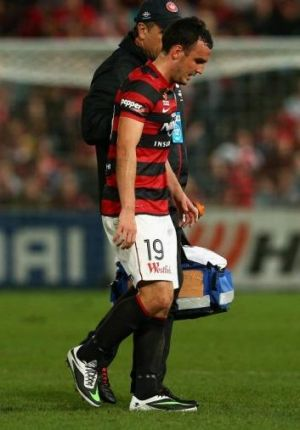 Injury concern: Mark Bridge left the pitch in the second half with an ankle injury.