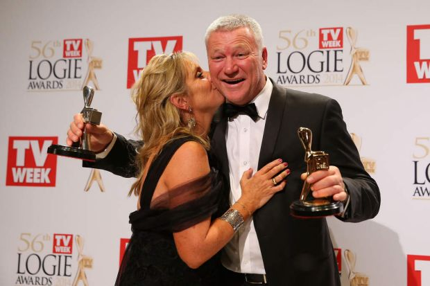 TV's biggest winner ... Scott Cam pose with his wife Ann in the awards room after winning the Gold Logie for Most ...