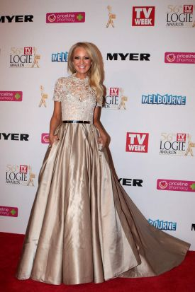 Missing out on gold, but took away best dressed ... Carrie Bickmore at the 2014 Logie Awards.