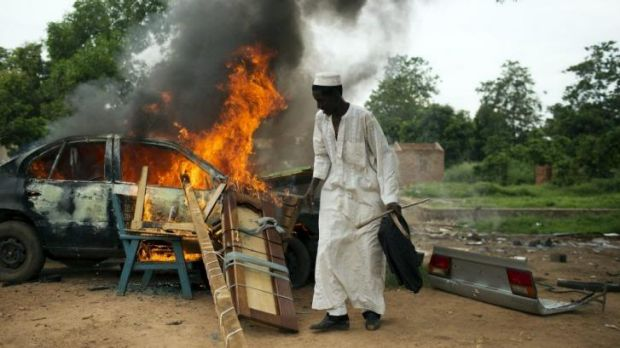 Some departing Muslims set their cars on fire as they could not take them in the convoy but did not want Christians to ...