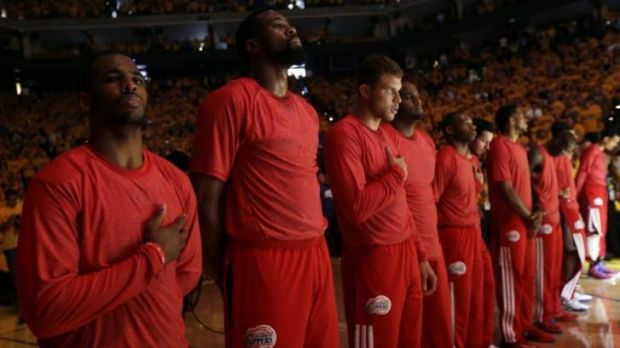 The Clippers protest with their shirts inside out as they listen to the national anthem before the game.