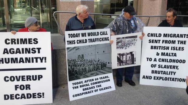 Protesters gather outside the public hearing in Perth.