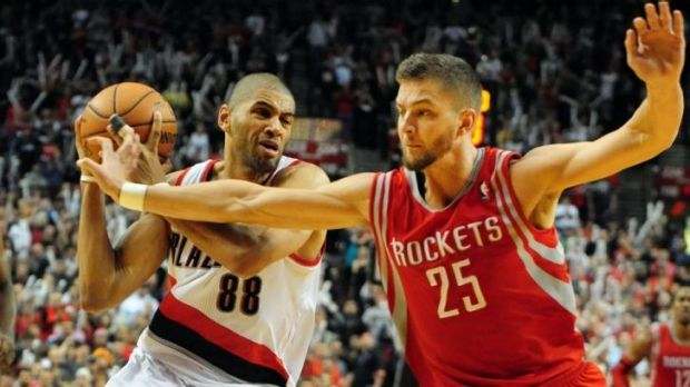 Portland's Nicolas Batum edges past Houston opponent Chandler Parsons.