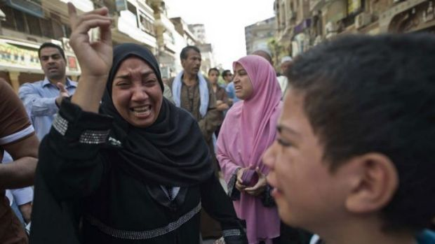 Egyptians react outside a court in Minya after Mohamed Badie and 682 others were sentenced death.