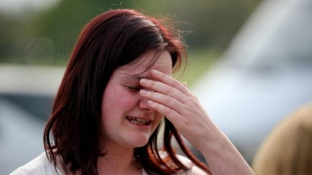 A former student cries outside Corpus Christi Catholic College.