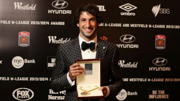 Thomas Broich of the Brisbane Roar poses with the Johnny Warren Medal at Royal Randwick Racecourse on Monday night.