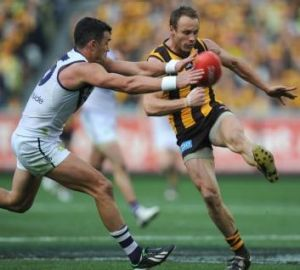 Brad Sewell (right) is chased by Ryan Crowley during the 2013 Grand Final against Fremantle.