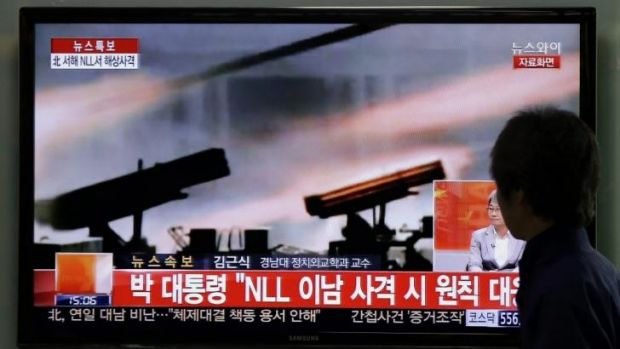 A man watches a news program reporting the North's live-fire artillery drills at a Seoul railway station.