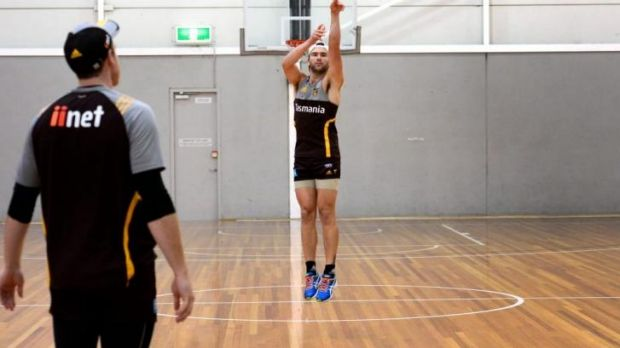 Hawk eye: Jordan Lewis (right) shoots some baskets with Hawthorn teammate Jarryd Roughead on Tuesday.