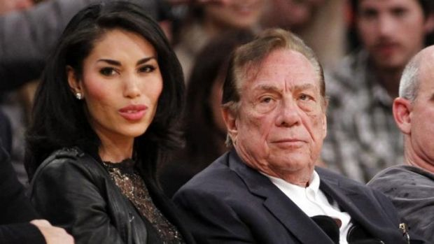 Life ban for racist comments ... Los Angeles Clippers owner Donald Sterling, right, sits with girlfriend V. Stiviano as ...