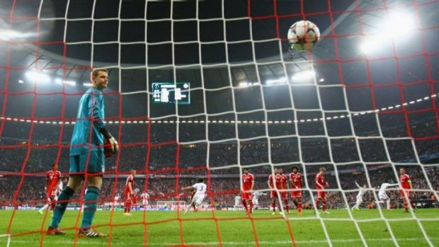 Manuel Neuer of Bayern Muenchen looks on as Cristiano Ronaldo of Real Madrid scores their fourth goal.
