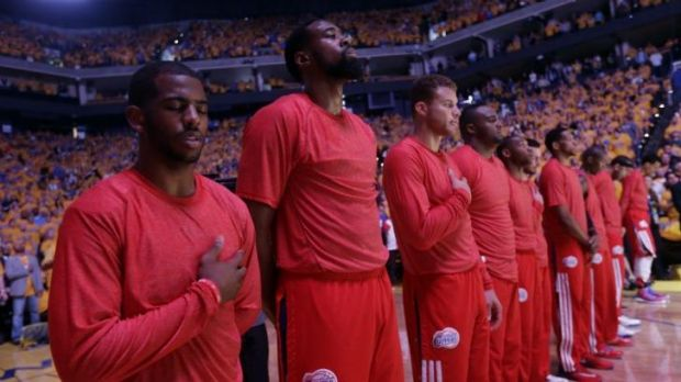Seeing red: The LA Clippers stage their protest.