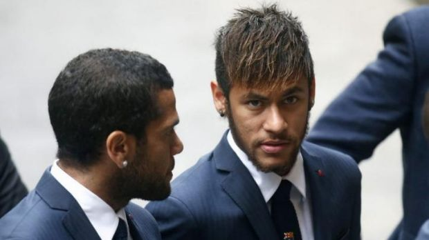FC Barcelona's football player Dani Alves, right, picked up and defiantly ate a banana that was thrown at him during a ...