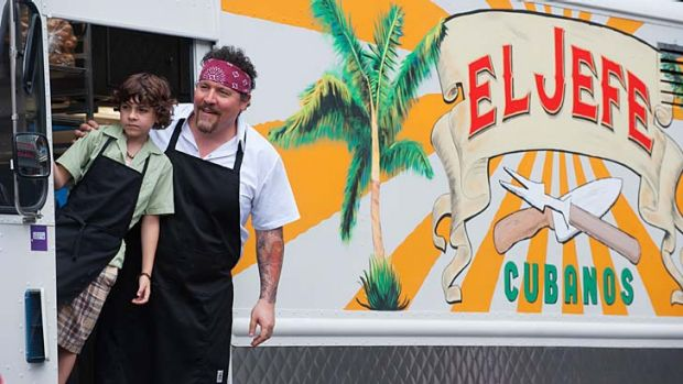 Change of diet: Emjay Anthony and Jon Favreau on the road in a taco truck in <i>Chef</i>.