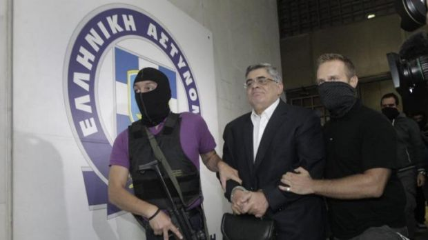 Far-right Golden Dawn party leader Nikos Mihaloliakos (centre) is escorted by anti-terrorism police officers as he ...