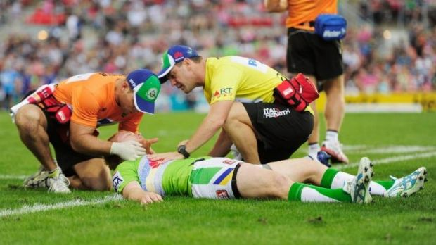 Joel Edwards of the Raiders receives treatment from trainers after a heavy hit during round five.