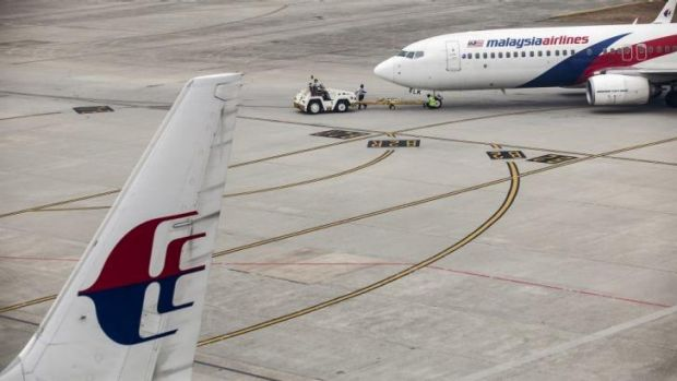 Malaysian Airline aircraft stand at Kuala Lumpur International Airport in Sepang. It took four hours for authorities to ...