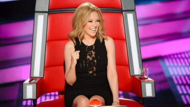 Playful: Kylie Minogue in the judge's chair on The Voice.