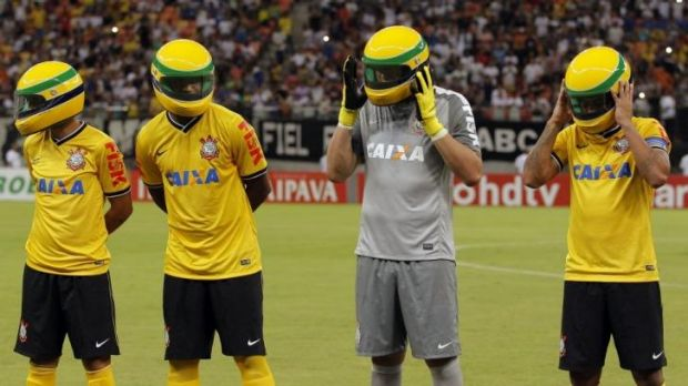 Players from the Corinthians soccer club wear replicas of the helmet worn by late Brazilian Formula One driver Ayrton Senna.