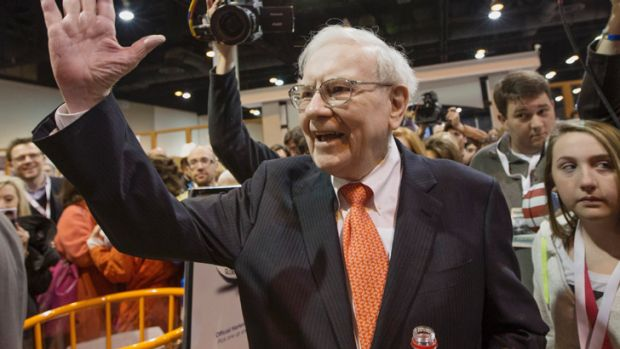Warren Buffett greets shareholders while touring the exhibit floor prior to holding the Berkshire Hathaway shareholders ...