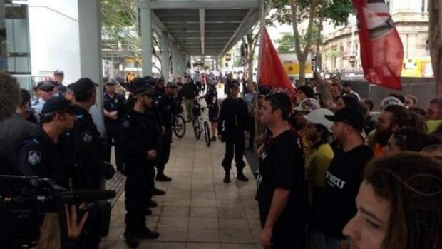 Police watch closely as anti-fascist protesters and Australia First Party members collide in Brisbane.