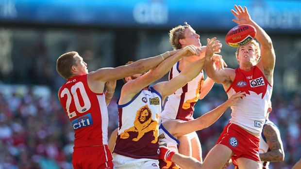 Luke Parker goes for a mark when the Lions and Swans clashed in season 2013.