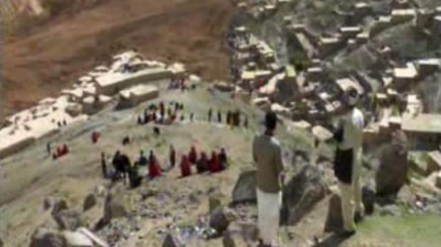 People search for survivors after a massive landslide buried a hundreds of homes in a village in Badakhshan province, ...