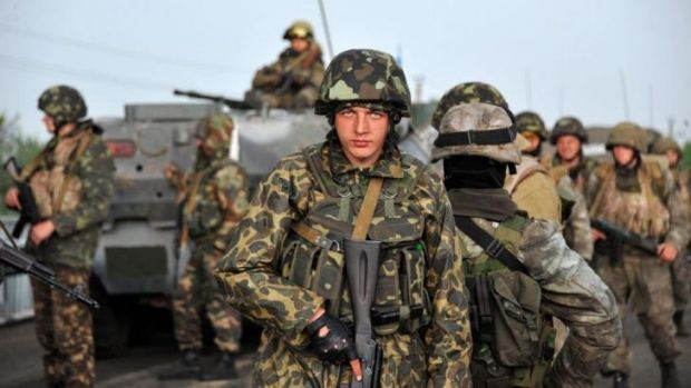 Ukrainian soldiers wait as Pro-Russia separatists block the road into Slavyansk to prevent them from advancing.