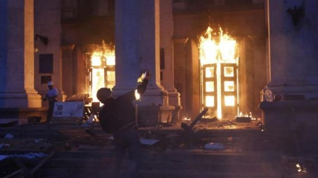 Deadly assault ... A protester throws a petrol bomb at the trade union building in Odessa.