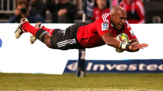 Nemani Nadolo of the Crusaders dives over to score a try during their rout of the ACT Brumbies in Christchurch.