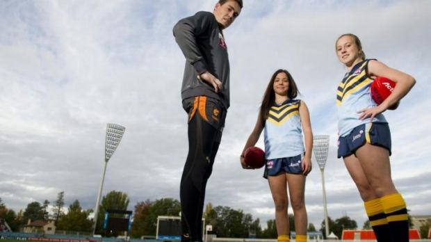 GWS Giants player Jeremy Cameron with ACT representatives for the National Championships Jessica Stramandinoli and ...