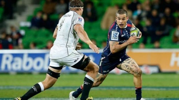 On the run: Rebel Tamati Ellison tries to evade the Sharks' Willem Alberts.