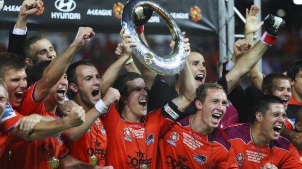 Roaring: Brisbane Roar players celebrate their come-from-way-behind A-League grand final victory over the Central Coast ...