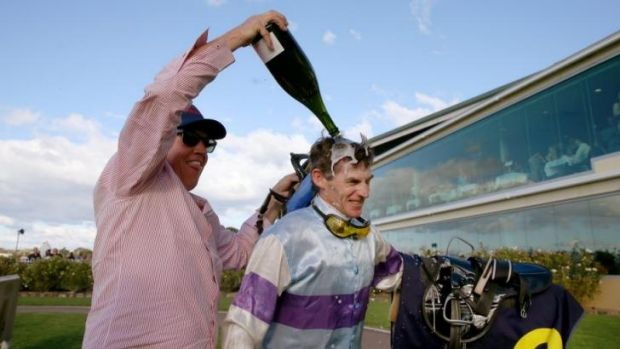 Congratulations: Robert Thompson is doused in champagne by his friend, Jeremy Sylvester, after his 4000th race win.