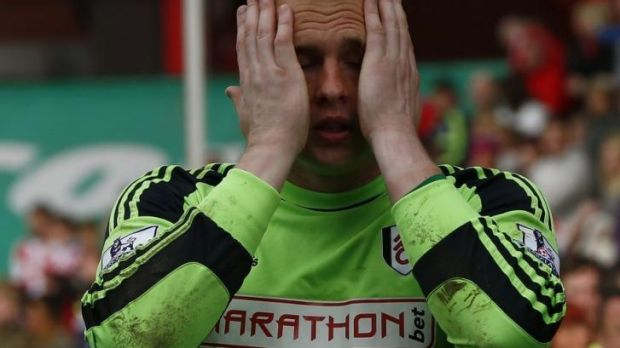 Distraught: Fulham goalkeeper David Stockdale after his side's loss to Stoke City ended their tenure in the Premier League.