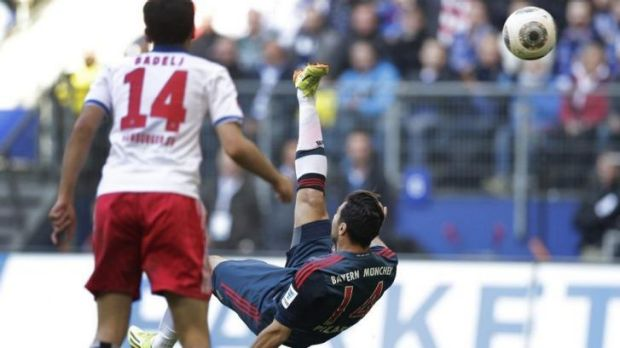 Claudio Pizarro of Bayern Munich scores his side's fourth goal.