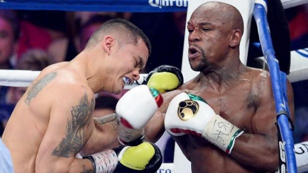 Floyd Mayweather throws a right-hander to the face of Argentinean opponent Marcos Maidana at the MGM Grand Garden Arena ...