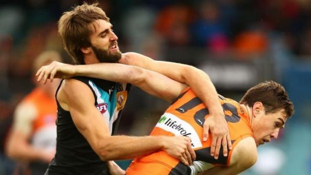 Power play: Jeremy Cameron of the Giants battles Justin Westhoff of the Power on Saturday.