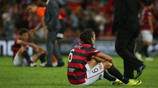 Inconsolable: Wanderers players were crestfallen after the grand final loss.
