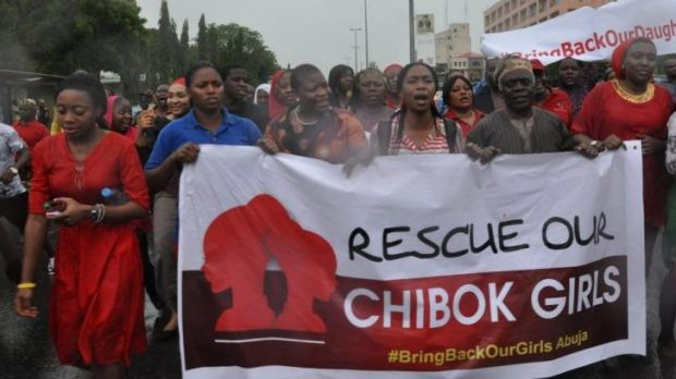 Public fury: Women attend a demonstration last week calling on the government to rescue the kidnapped schoolgirls.