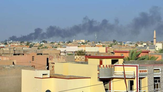 Smoke rises from buildings after shelling on the Iraqi city of Fallujah, west of the capital Baghdad, which has been ...