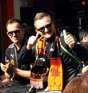 Besart Berisha (right) during the city parade for the Brisbane Roar.
