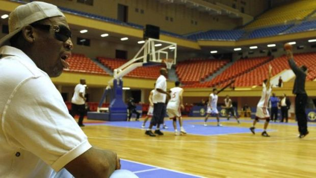 Dennis Rodman watches as North Korean and US basketball players practice in Pyongyang.