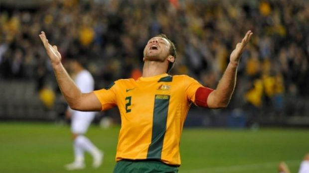In happier times: Lucas Neill celebrates victory over Jordan in 2013 that took Australia to the brink of qualification ...